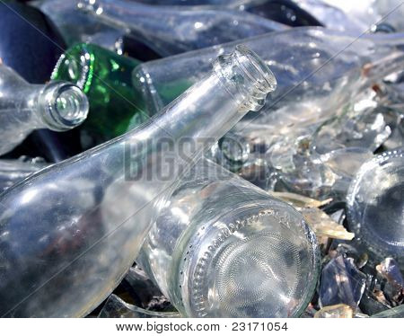 bottle glass in a recycle bin mound