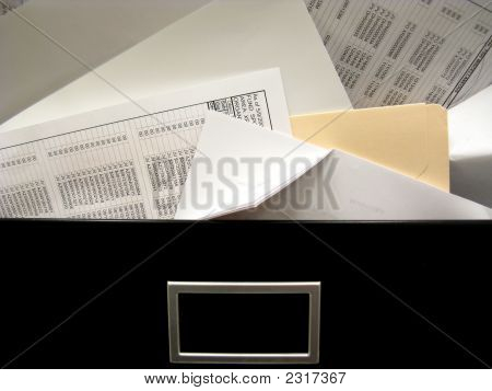 Overflowing File Drawer Stuffed With Paper
