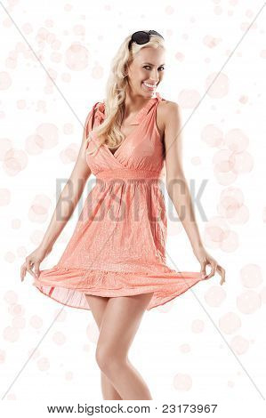 Blond Beautiful Girl Standing Against White Background Holding Her Dress Around The Bubbles