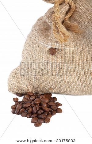 Coffee Beans Falling Out Of The Bag On A Pile Of Coffee Beans