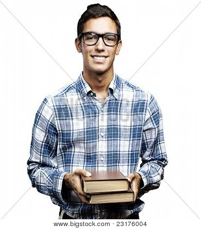 young student with glasses and shirt holding books over white background