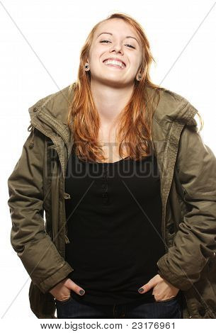 happy young redhead woman in parka