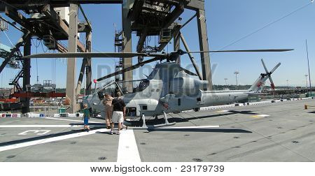 Civilians Inspect An Ah-1W Super Cobra Helicopter