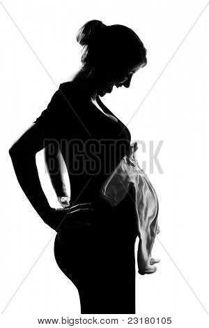 beautiful caucasian pregnant woman baby clothes in silhouette on studio isolated white background