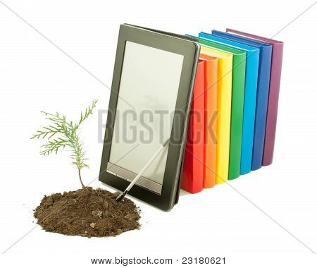 Tree Seedling With Row Of Books And Electronic Book Reader Behind Isolated On White