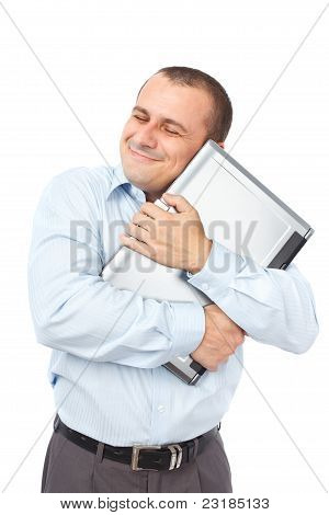 Happy Businessman Holding His Laptop