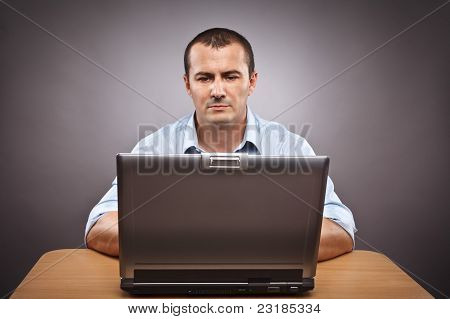 Businessman At His Laptop