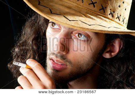 Man in cowboy hat smoking