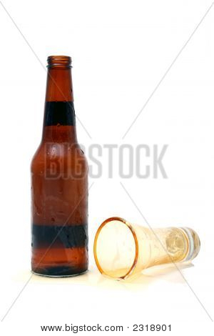 Beer Bootle And Spilled Glass