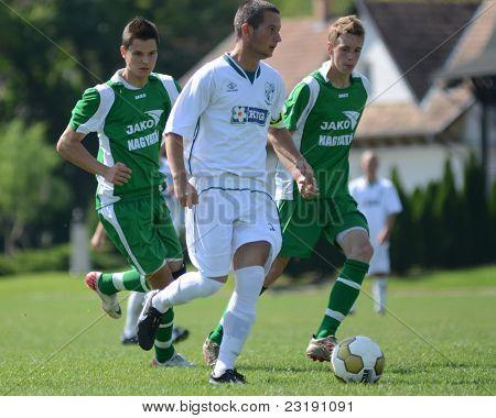 KAPOSVAR, HUNGARY - SEPTEMBER 5: Daniel Pager (white 3) in action at the Hungarian National Championship under 19 game Kaposvar (white) vs. Nagyatad (green) September 5, 2011 in Kaposvar, Hungary.