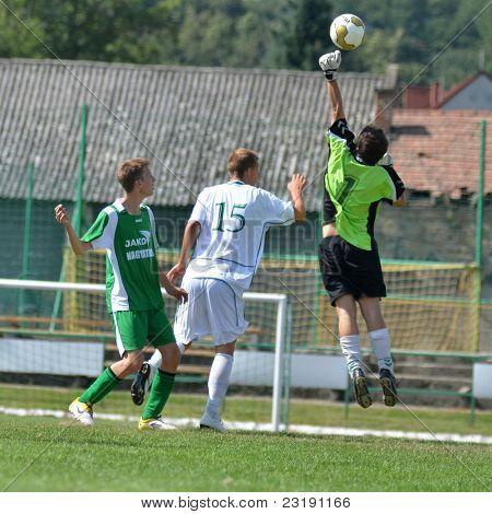 KAPOSVAR, HUNGARY - SEPTEMBER 5: Balazs Pinter (goalkeeper) in action at the Hungarian National Championship under 19 game Kaposvar (white) vs. Nagyatad (green) September 5, 2011 in Kaposvar, Hungary.