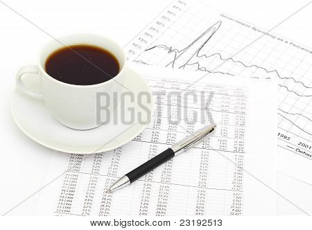 Accounting. Cup of coffee on document.