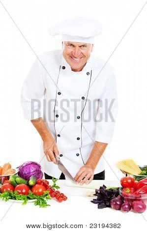 happy chef preparing salad against white background