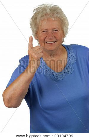 Senior Woman Whit Forefinger Up, On White Background