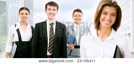 Image of beautyful business woman and her colleagues