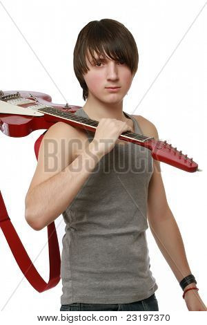 Guitarist with his guitar on the shoulder isolated on white background