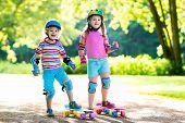 Children Riding Skateboard In Summer Park poster