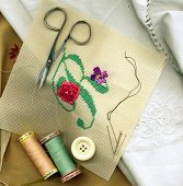 stock photo of embalming  - Sewing needle with bobbins of cotton thread and needlework - JPG