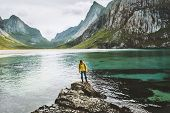 Traveler Man Standing Alone At Sea Stone Travel Lifestyle Adventure Concept Adventure Outdoor Active poster