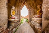 Ancient Buddha Ruins And Old Brick Wall On Ancient Monuments That Are Over 200 Years Old. Wat Nakhon poster