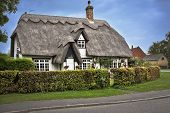 Cotswolds, Uk - October 12, 2014: Charming Thatched Roof House In The Cotswolds English Countryside. poster