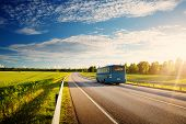 Bus On Asphalt Road In Beautiful Spring Day At Countryside poster