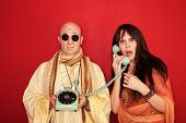image of swami  - Shocked and disappointed hippies over maroon background - JPG