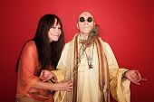 pic of swami  - Giggling woman with peacock feather tickles a meditating guru - JPG