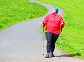 Happy overweight woman slimming and enjoying life on spring meadows. Healthy lifestyle concept. poster