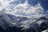 picture of snow capped mountains  - Hight mountains in clouds. Caucasus region Dombay.