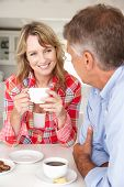 pic of portrait middle-aged man  - Mid age couple having coffee at home - JPG