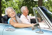 foto of mature men  - Senior couple in sports car - JPG
