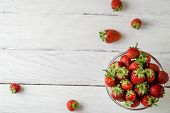 Top View Photo Of A Glass Plate With Ripe Red Strawberries On A White Wooden Table. Four Strawberrie poster