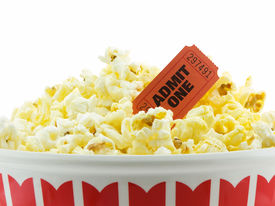 stock photo of movie theater  - Bucket of popcorn with a admit one movie ticket isolated on white - JPG