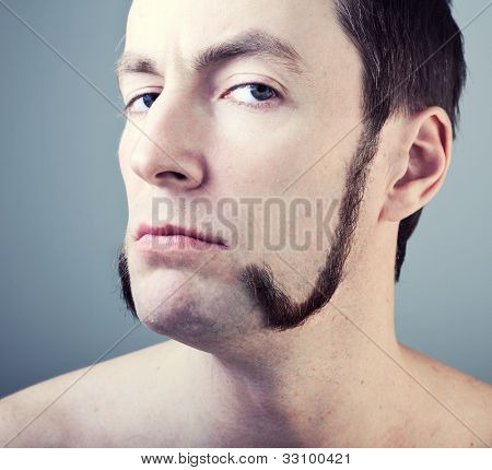 man with sideburns close-up photo