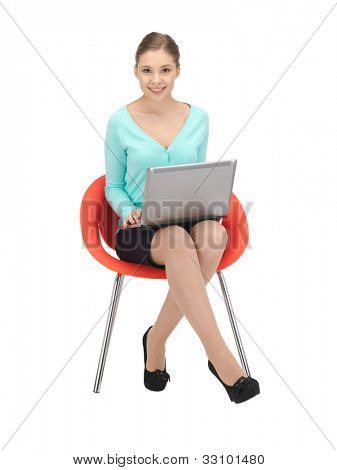 picture of young businesswoman sitting in chair with laptop