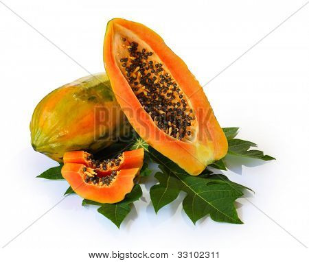 Ripe papaya and slices with seeds and green leaf isolated on a white background