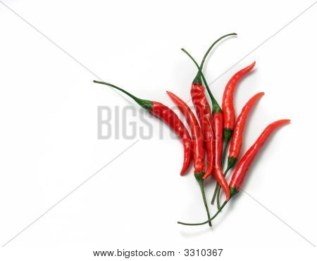 Red Chili Cayenne Peppers On White Background