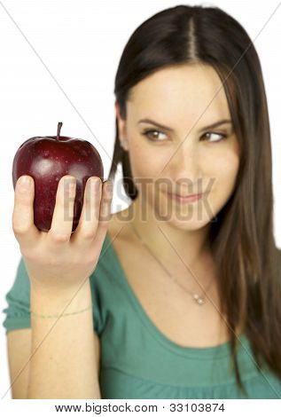 Girl Out Of Focus Watching Apple In Focus
