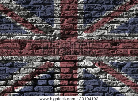 Section of old brick wall foverlaid with Union Jack flag