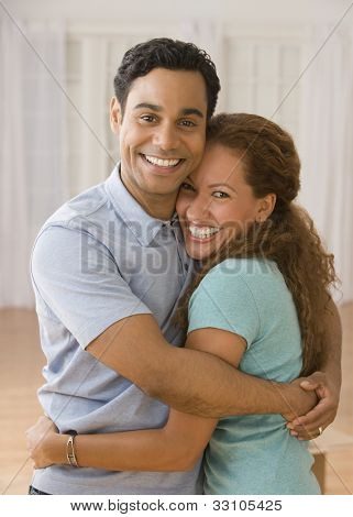 Hispanic couple hugging