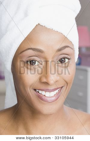 African American woman with towel around head