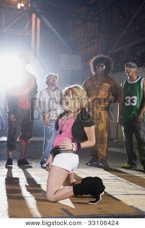 Multi-ethnic breakdancers in warehouse