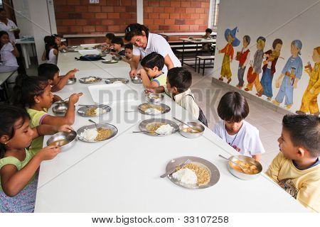 GUAYAQUIL, ECUADOR - FEBRUARY 8: Unknown children at lunch in the cafeteria after lessons by project to help deprived children in deprived areas with education, February 8, 2011 in Guayaquil, Ecuador.