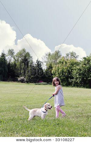 Little Girl Walking Her Puppy