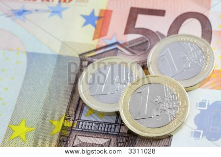Coins On Banknote