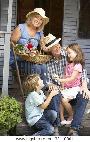 Senior couple on veranda with grandchildren