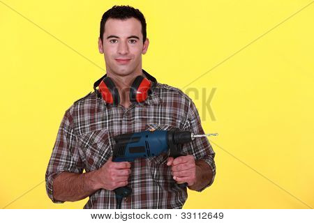 Man with soundproof earmuffs