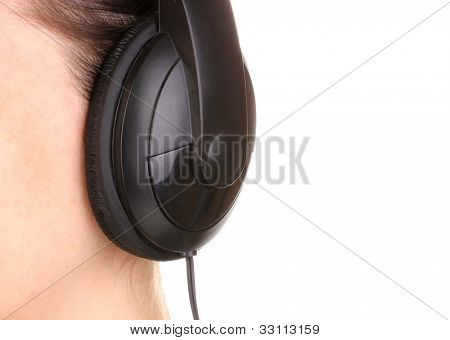 Human ear with earphone close-up isolated on white