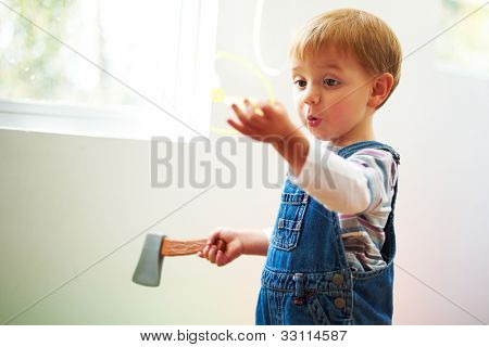 Little beautiful boy playing in his room